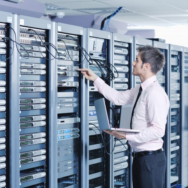 man with laptop in network room-2